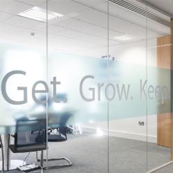 view of an office meeting room through glass doors