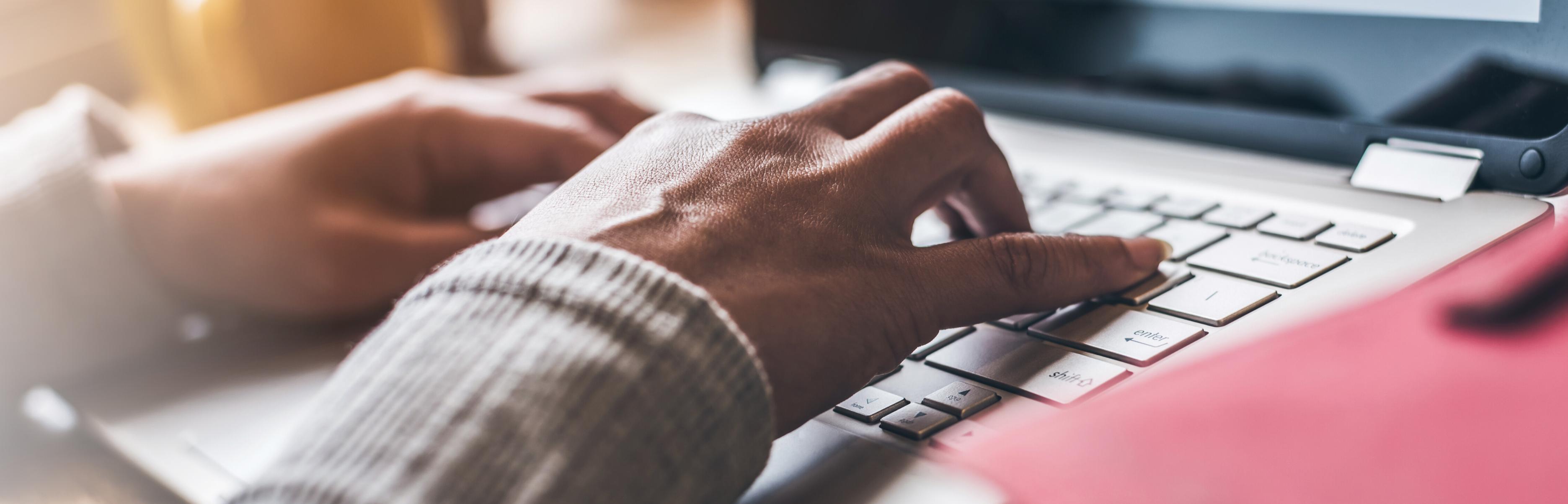 Woman Typing on Keyboard BOIPA