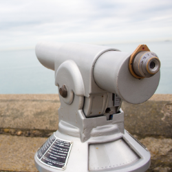 telescope on a viewpoint overlooking the sea